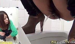 Japanese hos squat to pee over public toilet